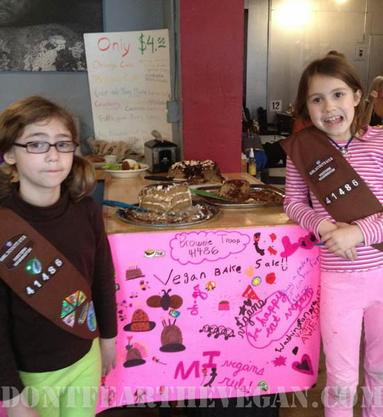Isabel and Anzia with the awesome sign their troop created!