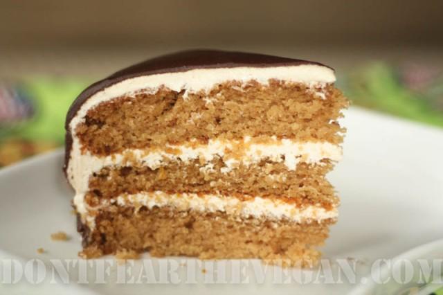 Orange cake with orange butter cream layers covered in orange chocolate ganache